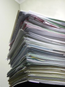 Stack of new graduate resumes