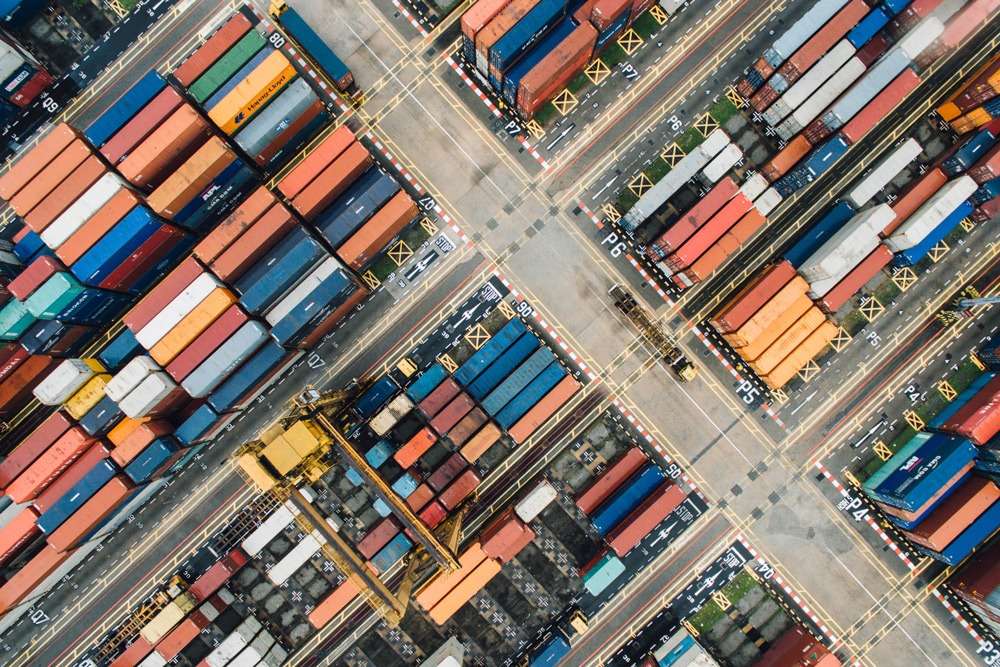 An aerial view of shipping containers that have arrived at port. An International Trade program will set you on an exciting career path that could involve many of these shipping containers.